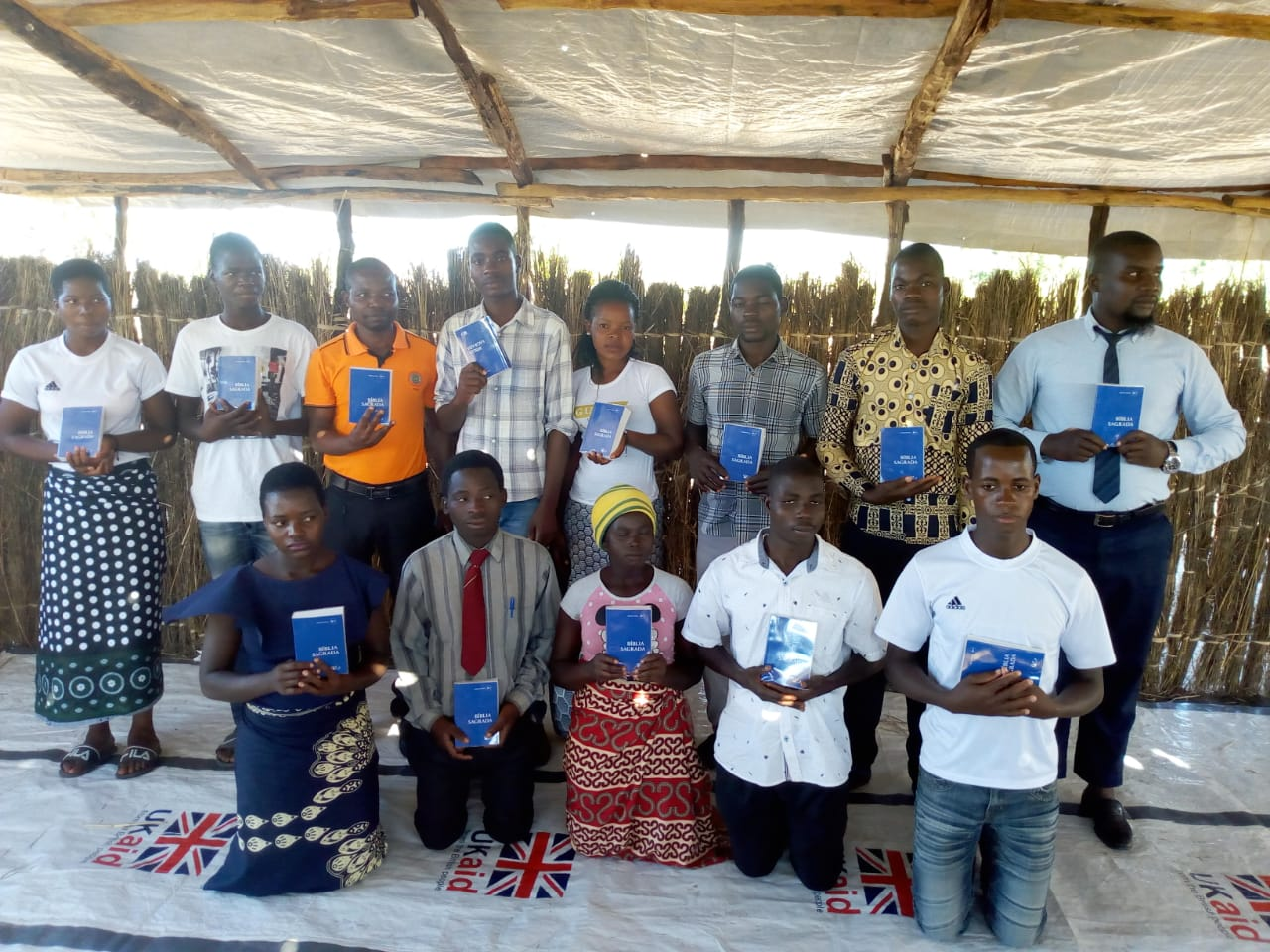 Bible study students with their new Bibles
